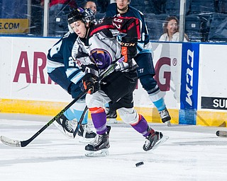 Scott R. Galvin | The Vindicator.Youngstown Phantoms center Matthew Barry (26) reaches for the puck during the first period against the Madison Capitols on Friday, Dec. 29, 2017 at the Covelli Centre.  The Phantoms lost 4-1.