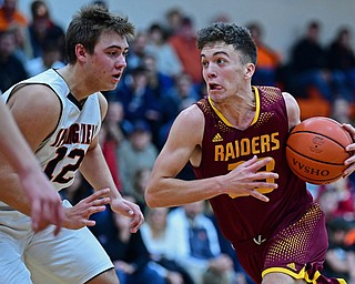NEW MIDDLETOWN, OHIO - DECEMBER 29, 2017: South Range's Jaxon Anderson drives on Springfield's Shane Eynon during the first half of their game on Friday night at Springfield High School. DAVID DERMER | THE VINDICATOR