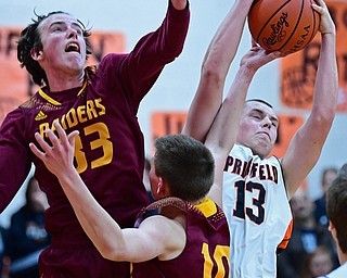 NEW MIDDLETOWN, OHIO - DECEMBER 29, 2017: Springfield's John Ritter grabs a rebound away from South Range's Chris Brooks and Brady White during the first half of their game on Friday night at Springfield High School. DAVID DERMER | THE VINDICATOR