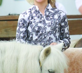 ROBERT K. YOSAY  | THE VINDICATOR..171st Canfield Fair is underway ..  Jewelina Reeveley (ok)  10 of Poland  shows her minature pony in the championship class at the 4-h ring