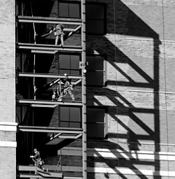 ROBERT K YOSAY  | THE VINDICATOR..Ironworkers build an outside stairwell with a good reflection of work on the wall as work continues on the Stambaugh Builiding being converted to a Double Tree by Hilton  owned by NYO property group..-30-