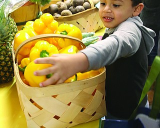 ROBERT K YOSAY  | THE VINDICATOR..Januhel Nieves-Vega- 4..  helps his mom get a pepper from the farmers market ..A $35,000 grant from the Swanston Foundation helped Alta Head Start at families to get fresh produce from a semi-annual farmersÕ market...-30-