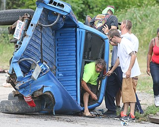 ROBERT K. YOSAY  | THE VINDICATOR..a two vehicle wreck at  Hillman and Myrtle  had a vehicle on its side.. as neighbors helped people out of the truck..  the wreck involved a pickup truck and a car  just after noon today (thursday)