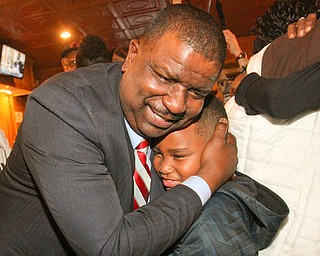 William D Lewis The Vindicator Tito Brown is all smiles as he hugs his son Quentin, 7, during victory party at MVR 11-7-2-17.