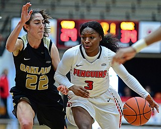 YOUNGSTOWN, OHIO - DECEMBER 30, 2017: Youngstown State's Indiya Benjamin drives on Oakland's Taylor Gleason during the second half of their game on Saturday afternoon at Beegley Center. Oakland won 58-48. DAVID DERMER | THE VINDICATOR