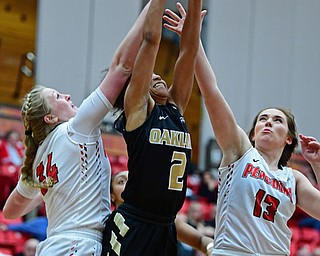 YOUNGSTOWN, OHIO - DECEMBER 30, 2017: Oakland's  Korrin Taylor grabs a rebound away from Youngstown State's Morgan Brunner and McKenah Peters during the second half of their game on Saturday afternoon at Beegley Center. Oakland won 58-48. DAVID DERMER | THE VINDICATOR