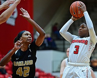 YOUNGSTOWN, OHIO - DECEMBER 30, 2017: Youngstown State's Indiya Benjamin shoots over Oakland's Mercy Agwaniru during the second half of their game on Saturday afternoon at Beegley Center. Oakland won 58-48. DAVID DERMER | THE VINDICATOR