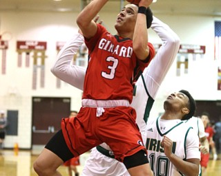 Anthony Backus(3) of Girard goes up for a layup during the 2nd quarter as Girard takes on Ursuline, Thursday, March 9, 2017 at Boardman High School. Ursuline won 62-53...(Nikos Frazier | The Vindicator)..