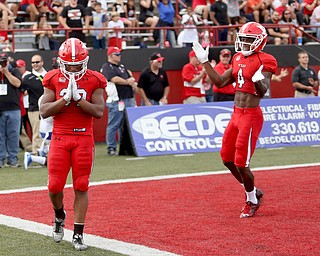 Youngstown State University tail back Tevin McCaster (37) places his hands together after scoring a touchdown as he is congratulated by Youngstown State University wide receiver Damoun Patterson (4) in the first quarter as Youngstown State takes on Central Connecticut State, Saturday, Sept. 16, 2017, at Stambaugh Stadium in Youngstown. Youngstown State won 59-9...(Nikos Frazier | The Vindicator)..