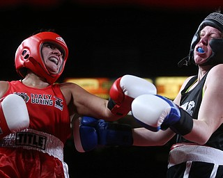 Collen Davis(black) receives a left hook from Jessica Palmieri(red), Thursday, Oct. 5, 2017, at the Covelli Centre in Youngstown. Palmieri won after three rounds by points...(Nikos Frazier | The Vindicator)..