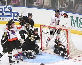 Muskegon Lumberjacks forward Monte Graham (11) and Muskegon Lumberjacks goalie Adam Brizgala (1)  collide to allow Youngstown Phantoms center Curtis Hall (20)'s goal during the second period as the Muskegon Lumberjacks take on the Youngstown Phantoms, Saturday, Oct. 21, 2017, at the Covelli Centre in Youngstown...(Nikos Frazier | The Vindicator)..