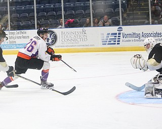 Youngstown Phantoms forward Matthew Barry (26) scores a goal against Muskegon Lumberjacks goalie Adam Brizgala (1) during the second period of a USHL hockey game, Wednesday, Nov. 22, 2017, at the Covelli Centre in Youngstown. Phantoms won 7-3...(Nikos Frazier | The Vindicator)..