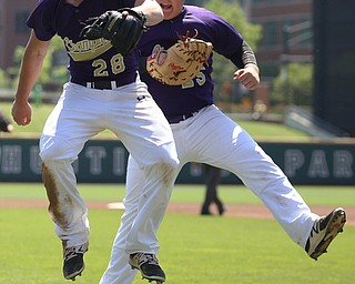 Champion Golden Flashes pitcher Andrew Russel (28) and Champion Golden Flashes first baseman AJ Meyer (25) celebrate the third out in the sixth inning as Champion takes on Berlin Hiland in the DIII baseball championship, Saturday, June 3, 2017 at Huntington Park in Columbus. Champion won 1-0...(Nikos Frazier | The Vindicator)