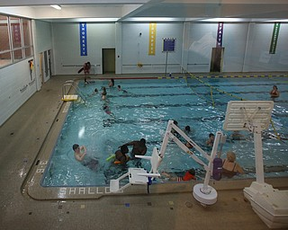 Families enjoy the free swim during First Night Youngstown, Sunday, Dec. 31, 2017, at the YMCA in Youngstown. ..(Nikos Frazier | The Vindicator)