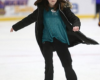 Kylie Sykes(11) of Beaver Township ice skates during First Night Youngstown, Sunday, Dec. 31, 2017, at the Covelli Centre in Youngstown. ..(Nikos Frazier | The Vindicator)