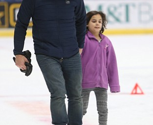 Tony DiStefano of Boardman holds hands with his daughter, Simona(7) as they ice skate during First Night Youngstown, Sunday, Dec. 31, 2017, at LOCATION in Youngstown. ..(Nikos Frazier | The Vindicator)