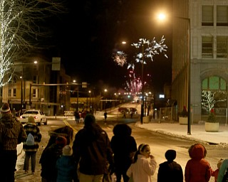 People watch the fireworks display during First Night Youngstown, Sunday, Dec. 31, 2017, in downtown Youngstown. ..(Nikos Frazier | The Vindicator)