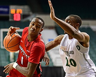 YOUNGSTOWN, OHIO - JANUARY 1, 2018: Youngstown State's Braun Hartfield loses control of the ball while driving on Clevaldn State's Bobby Word during the second half of their game on Saturday afternoon at the Wolstein Center. Youngstown State won 80-77. DAVID DERMER | THE VINDICATOR