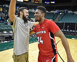 YOUNGSTOWN, OHIO - JANUARY 1, 2018: Youngstown State's Cameron Morse gets a hug from Francisco Santiago after he hit the game winning three point shot on Saturday afternoon at the Wolstein Center. Youngstown State won 80-77. DAVID DERMER | THE VINDICATOR