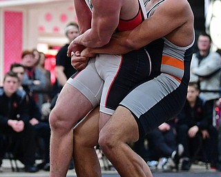 NILES, OHIO - JANUARY 3, 2018: Howland's Brandon Matlock attempts to pick up Canfield's Tyler Stein during their 220lb bout, Wednesday nigh at the Eastwood Mall. DAVID DERMER | THE VINDICATOR