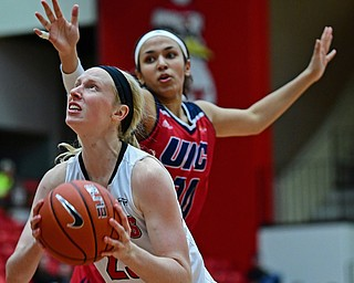 YOUNGSTOWN, OHIO - JANUARY 4, 2017: Youngstown State's Sarah Cash goes to the basket against Illinois-Chicago's Teodora Zagorac during the first half of their game, Thursday night at Beeghly Center. 76-63. DAVID DERMER | THE VINDICATOR