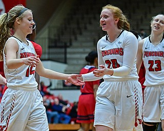 YOUNGSTOWN, OHIO - JANUARY 4, 2017: Youngstown State's Chelsea Olsen, left, is congratulated by Kelly Wright after making a three point basket as time expired in the third quarter of their game, Thursday night at Beeghly Center. 76-63. DAVID DERMER | THE VINDICATOR