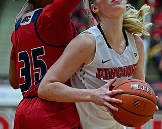 YOUNGSTOWN, OHIO - JANUARY 4, 2017: Youngstown State's Sarah Cash goes to the basket against Illinois-Chicago's Tylah Lampley during the second half of their game, Thursday night at Beeghly Center. 76-63. DAVID DERMER | THE VINDICATOR