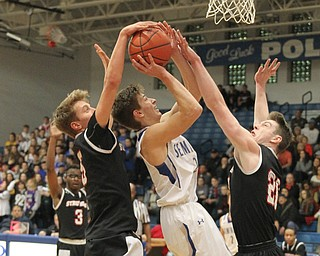 Poland's Mike Diaz (2) gets blocked while going up for a shot by Jake Ryan (5) and Ryan Leonard (20) during the first half of Thursday nights matchup at Poland High School.   Dustin Livesay  |  The Vindicator  1/4/18  Poland.
