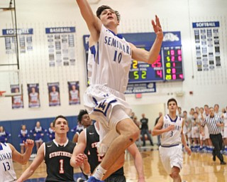 Poland's Daniel Kramer (10) goes up for a dunk during the first half of Thursday nights matchup against Struthers at Poland High School.   Dustin Livesay  |  The Vindicator  1/4/18  Poland.