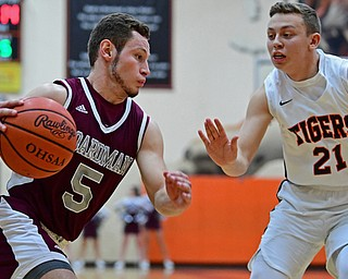 HOWLAND, OHIO - JANUARY 5, 2018: Boardman's Mike Melewski drives on Howland's Frankie Manios during the first half of their game, Friday night at Howland HigH School. DAVID DERMER | THE VINDICATOR
