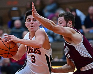 HOWLAND, OHIO - JANUARY 5, 2018: Howland's Frank Rappach drives on Boardman's Mike Melewski during the second half of their game, Friday night at Howland HigH School. DAVID DERMER | THE VINDICATOR