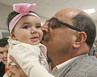 William D. Lewis the Vindicator  Zl Adi kisses Sophia Niser, 5 months during a vicotry party at the Arab American Community Center after winning a stay of deportation. Sophia is a daughter of Amal and Nedal Niser of Liberty.