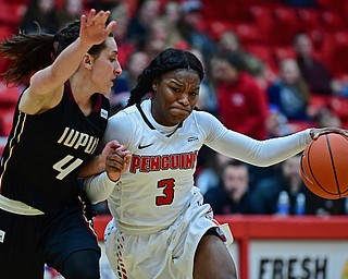 YOUNGSTOWN, OHIO - JANUARY 6, 2017: Youngstown State's Indiya Benjamin drives on IUPUI's Holly Hoppingarner during the second half of their game, Saturday afternoon at Beeghly Center. IUPUI won 65-43. DAVID DERMER | THE VINDICATOR