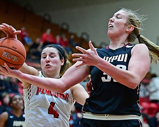 YOUNGSTOWN, OHIO - JANUARY 6, 2017: IUPUI's Jenna Gunn attempts to control the ball before being hit by Youngstown State's Nikki Arbanas during the second half of their game, Saturday afternoon at Beeghly Center. IUPUI won 65-43. DAVID DERMER | THE VINDICATOR