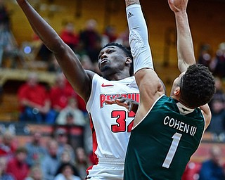 YOUNGSTOWN, OHIO - JANUARY 6, 2017: Youngstown State's Garrett Covington goes to the basket against Green Bay's Sandy Cohen III during the first half of their game, Saturday night at Beeghly Center. DAVID DERMER | THE VINDICATOR