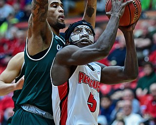 YOUNGSTOWN, OHIO - JANUARY 6, 2017: Youngstown State's Jeremiah Ferguson goes to the basket against Green Bay's Manny Patterson during the first half of their game, Saturday night at Beeghly Center. DAVID DERMER | THE VINDICATOR