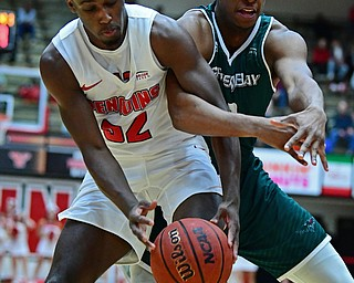 YOUNGSTOWN, OHIO - JANUARY 6, 2017: Youngstown State's Garrett Covington and Green Bay's TJ Parham battle for a loose ball during the first half of their game, Saturday night at Beeghly Center. DAVID DERMER | THE VINDICATOR