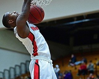 YOUNGSTOWN, OHIO - JANUARY 6, 2017: Youngstown State's Braun Hartfield dunks over Green Bay's PJ Pipes during the first half of their game, Saturday night at Beeghly Center. DAVID DERMER | THE VINDICATOR