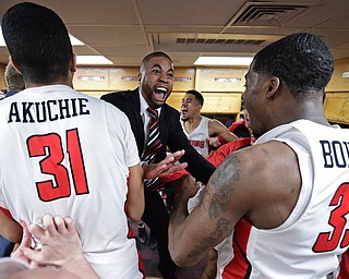 YOUNGSTOWN, OHIO - JANUARY 6, 2017: Youngstown State assistant coach Jason Slay celebrates with Michael Akuchie and Naz Bohannon in the locker room after YSU defeated Green Bay 85-74, Saturday night at Beeghly Center. DAVID DERMER | THE VINDICATOR