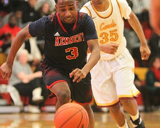William D. Lewis The VindicatorJFK's Terrance King(3) and Mooney'sJordan Standford (35) pursue the ball.