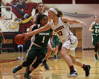 South Range's Bree Kohler (12) steals the ball from Ursuline's Dayshanette Harris (1) in the first half of an OSHAA girls high school basketball game, Thursday, Jan. 11, 2018, in Canfield. South Range won 54-49...(Nikos Frazier | The Vindicator)