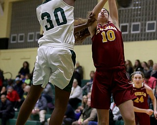 Ursuline's Anyah Curd (30) spikes the ball out of Cardinal Mooney Carolyn Kay (10)s hands as Kay was going up for a layup in the first quarter of an OSHAA basketball game, Thursday, Feb. 1, 2018, in Youngstown. Ursuline won 76-54...(Nikos Frazier | The Vindicator)