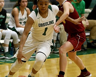 Ursuline's Dayshonette Harris (1) pushes past Cardinal Mooney Carolyn Kay (10) to go up for a layup in the third quarter of an OSHAA basketball game, Thursday, Feb. 1, 2018, in Youngstown. Ursuline won 76-54...(Nikos Frazier | The Vindicator)