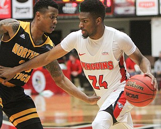 WilliamD. Lewis The Vindicator YSU's Cam Morse(24) drives around NKU's Lavonne Holland(30) during 2-1-18 action at YSU.