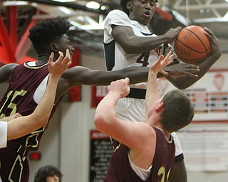 William D. Lewis The Vindicator  Campbell's Eric Van Cobb(4) pulls down a rebound past Liberty's Ezell Brown(15) and David Sewell(21) during 2-2-18 action at Liberty.