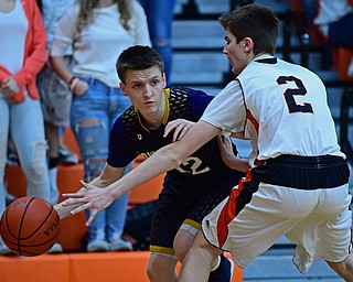 NEW MIDDLETOWN, OHIO - FEBRUARY 2, 2018: Lowellville's Anthony Mesaros looks to pass while being pressured by Springfield's Drew Clark during the first half of their game on Friday night at Springfield High School. DAVID DERMER   THE VINDICATOR