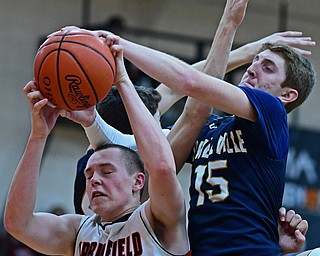 NEW MIDDLETOWN, OHIO - FEBRUARY 2, 2018: Springfield's John Ritter grabs a rebound away from Lowellville's Jake Rotz during the second half of their game on Friday night at Springfield High School. DAVID DERMER   THE VINDICATOR