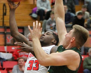 William D. Lewis The Vindicator YSU's Naz Bohannon(33) shoots past WSU's Loudon Love(11)during 2-3-18 action at YSU.