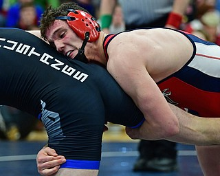 AUSTINTOWN, OHIO - FEBRUARY 3, 2018: Fitch's Michael Ferree grabs the leg of Grand Valley's Clayton Takacs during their 160lb EOWL Championship bout, Saturday night at Austintown Fitch High School. DAVID DERMER   THE VINDICATOR