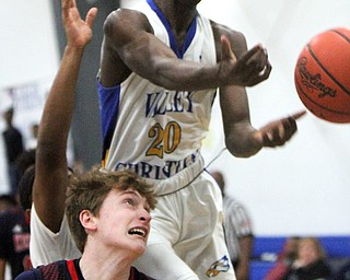 William D Lewis The Vindicator  VCS Damon Christian(20) and JFK's Gianni Eaton(4) go for a rebound.